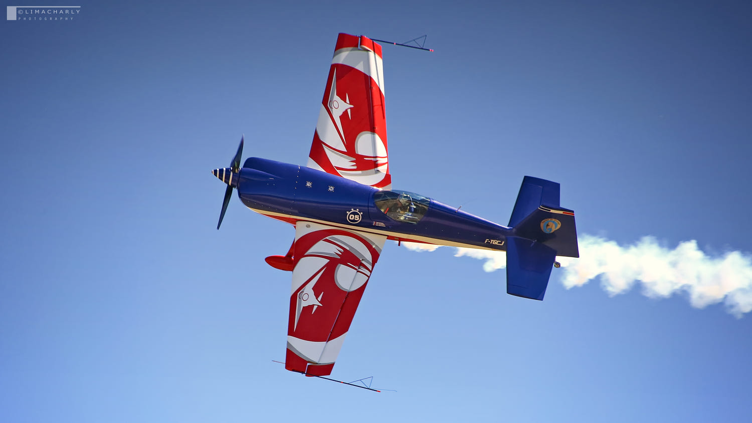French aerobatic Extra 300 during airshow by Laurent Couture