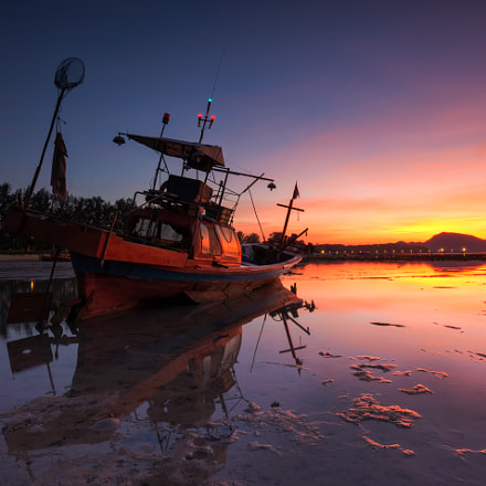 Good Morning fishing boat with sunrise or sunset background