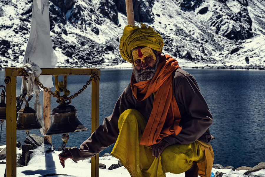 Sadhu ringing the bell at gosaikunda lake