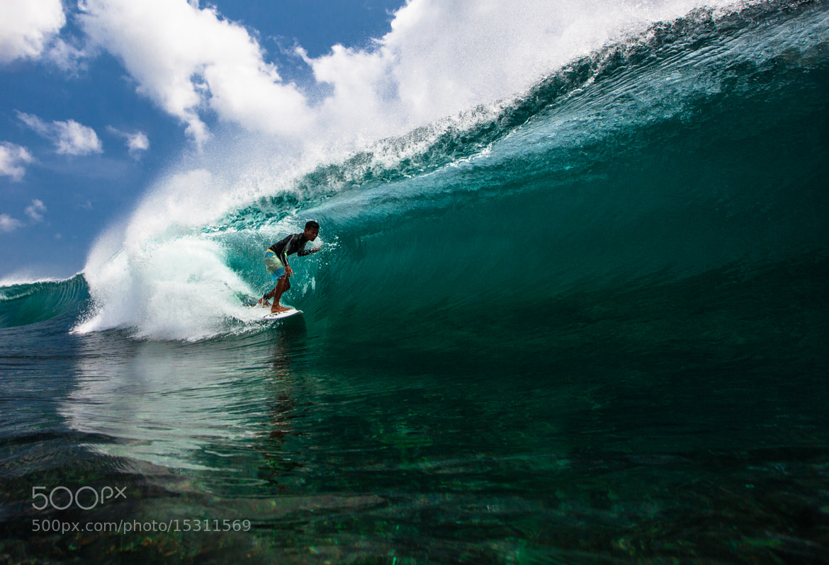 Photograph Surfing a Blue Barrel in Bali by Tommy Schultz on 500px