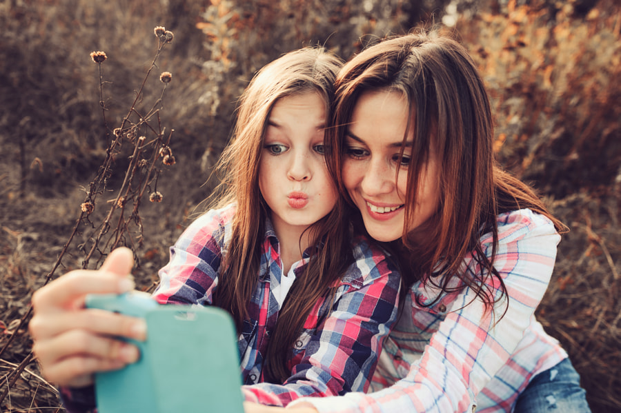 happy mother and daughter making selfie by Maria Kovalevskaya on 500px.com