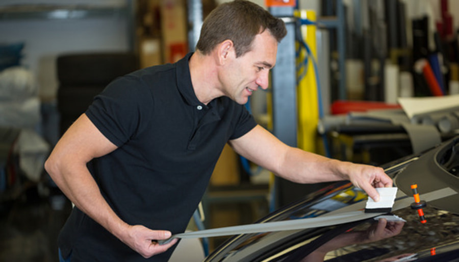 Car wrapper straightening foil with a squeegee by Vehicle  Wrap Pros on 500px.com