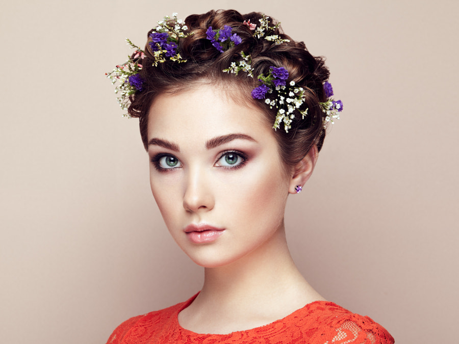 Face of beautiful woman decorated with flowers by Oleg Gekman on 500px.com