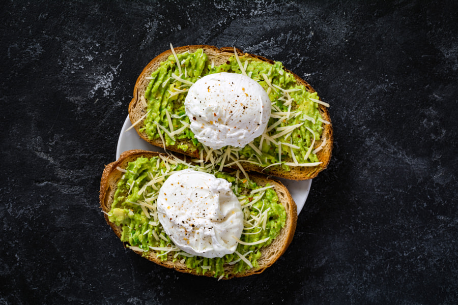 Avocado and poached egg toasts by Vladislav Nosick on 500px.com