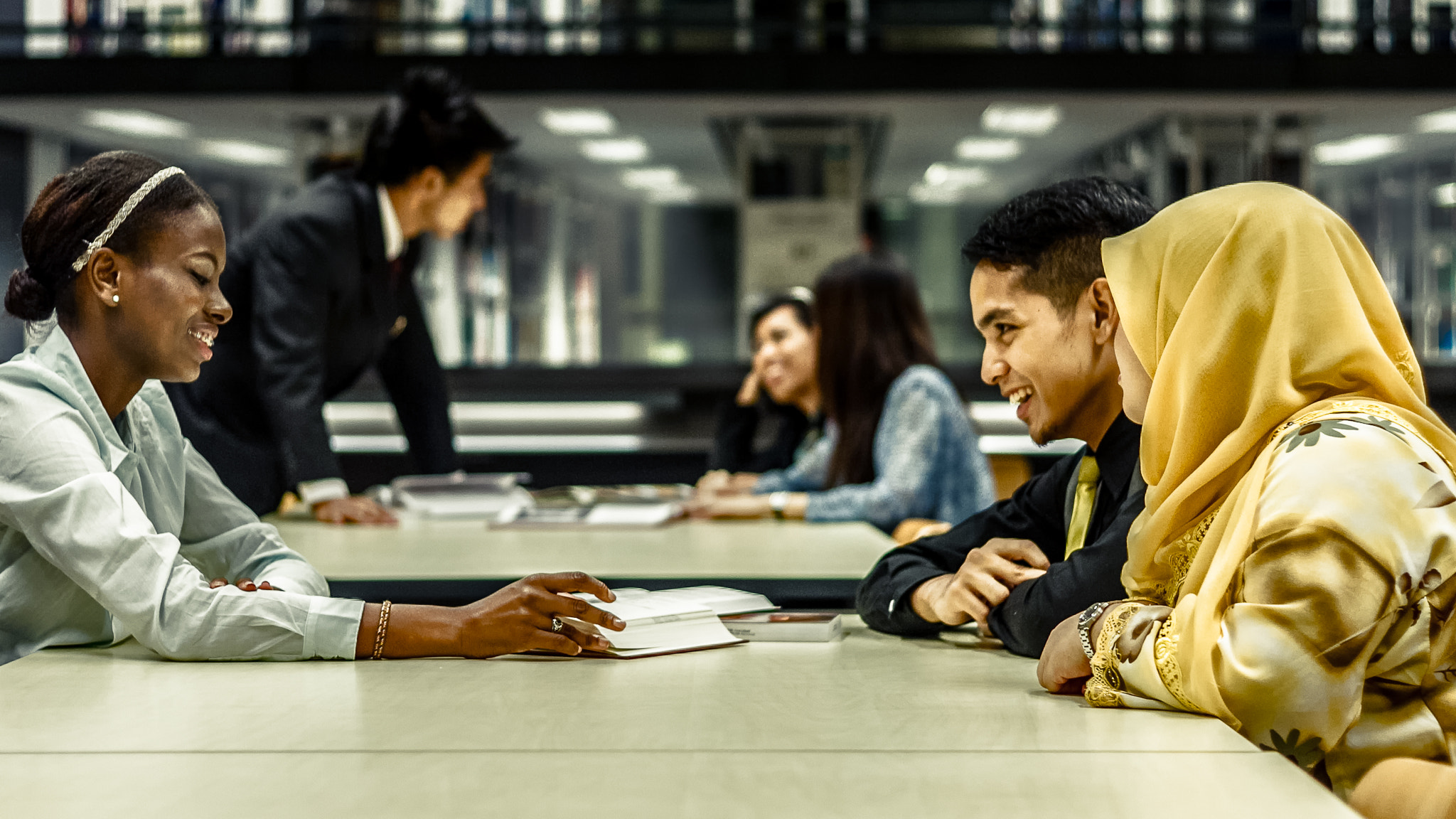 Photograph Student Discussing at Library by Aqwa Qawiem on 500px