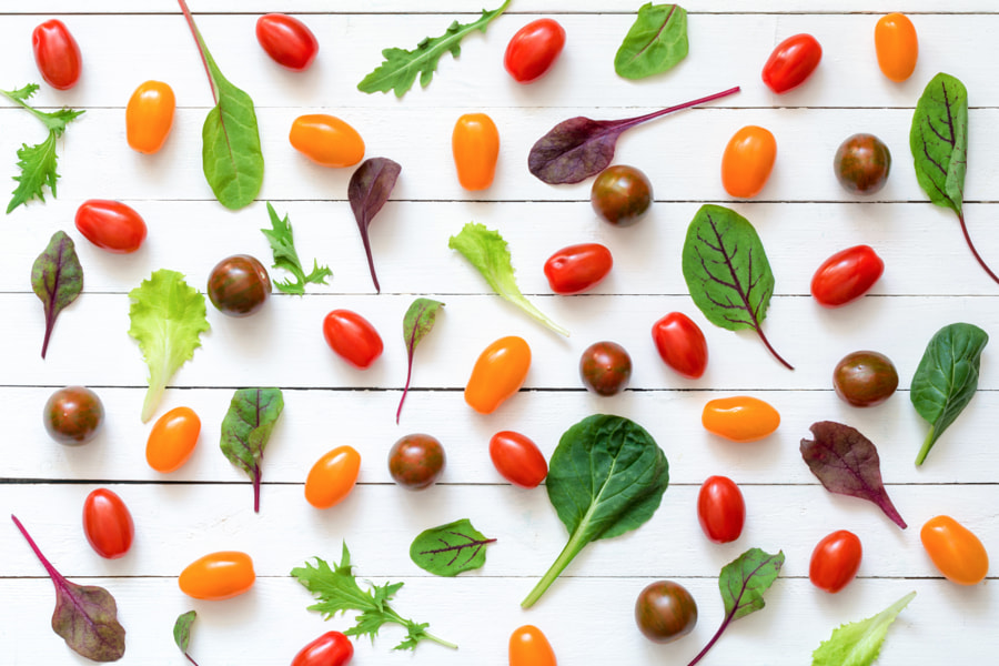 Fresh greens and tomatoes on white background by Vladislav Nosick on 500px.com
