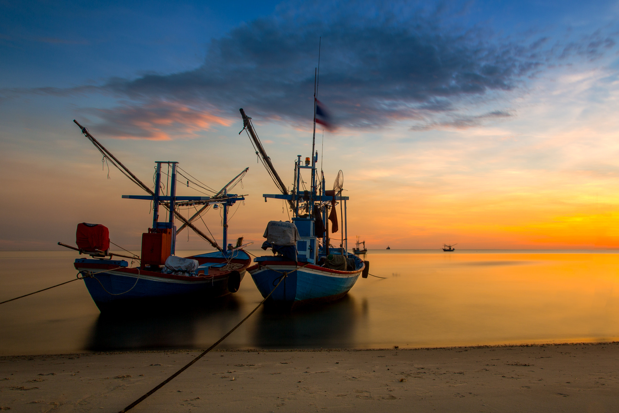 Photograph Two Boat in sunset by Arthit Somsakul on 500px
