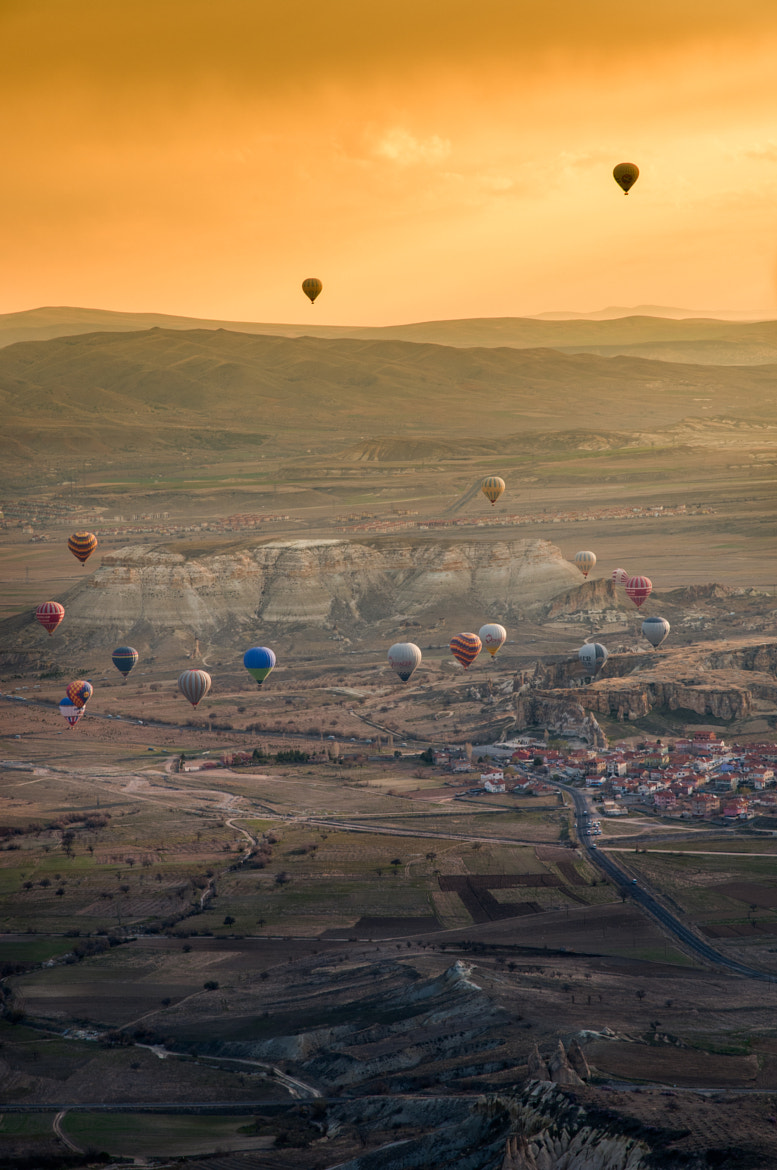 Photograph Hot-air balloon flying over the landscape of Cappadocia by Natapong P. on 500px