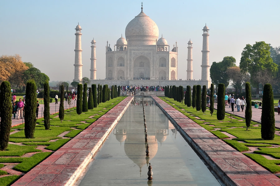 Taj Mahal building is impressive every time of the day, but specially at sunrise and sunset the inmacullate white marble stone bricks turn onto different colours from palid red, pink , yellow and cream