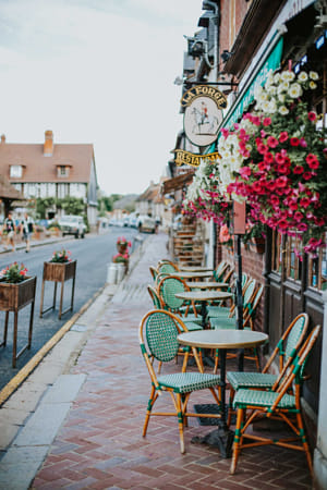 green chairs in beuvron en auge by Adriana Manni on 500px