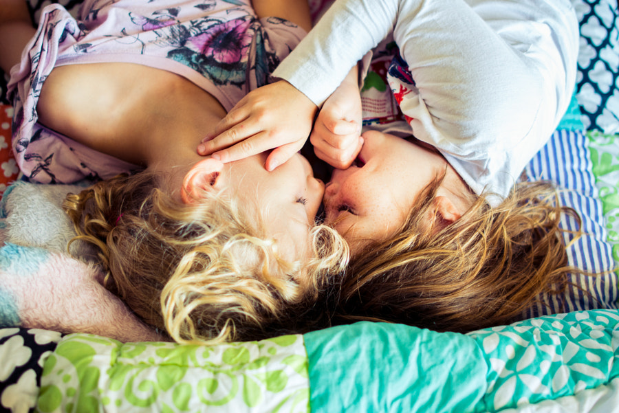 Two sisters enjoying a happy cuddle at home by L O L A   M E D I A on 500px.com