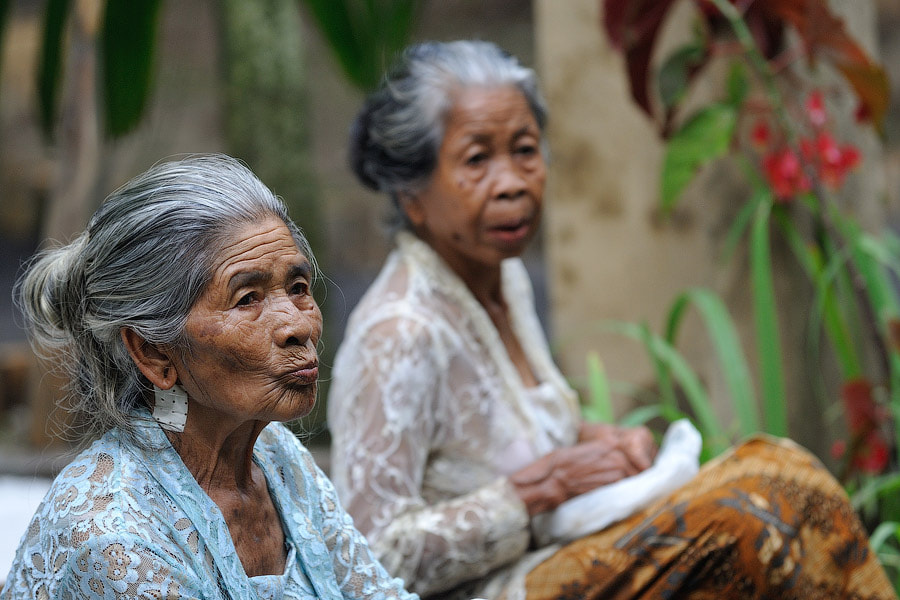 Photograph Balinese gossips on sacred ceremony, Bali by Vitaly Taysaev on 500px