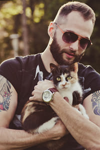 Cat in the hands of man by Klassy Goldberg on 500px