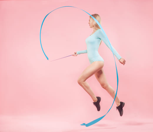 blonde woman with gymnastic ribbon by Heather Balmain on 500px