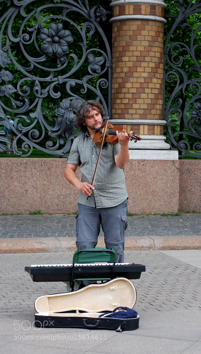 Photograph Street musician by Tatyana Poleva on 500px