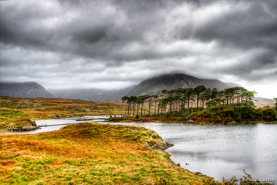 Ballynahinch Lake under a cloudy sky near Connemara national park.
