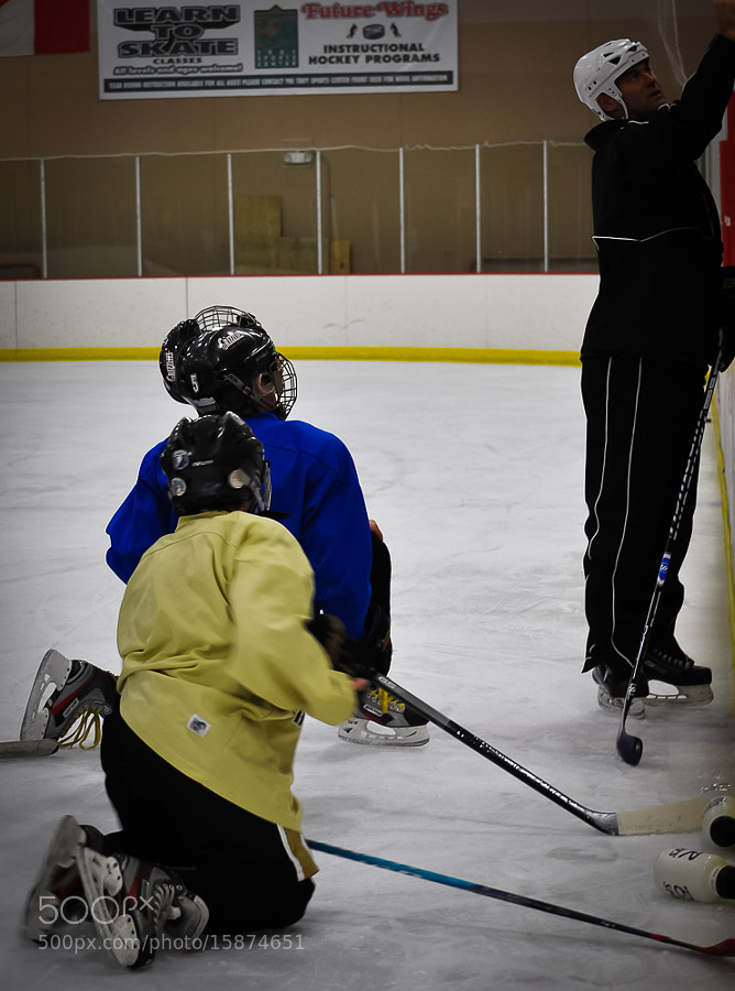 Retired NHL player Bryan Smolinski coaches my nephew's team. Shown here outlining a play to the AAA team during practice.