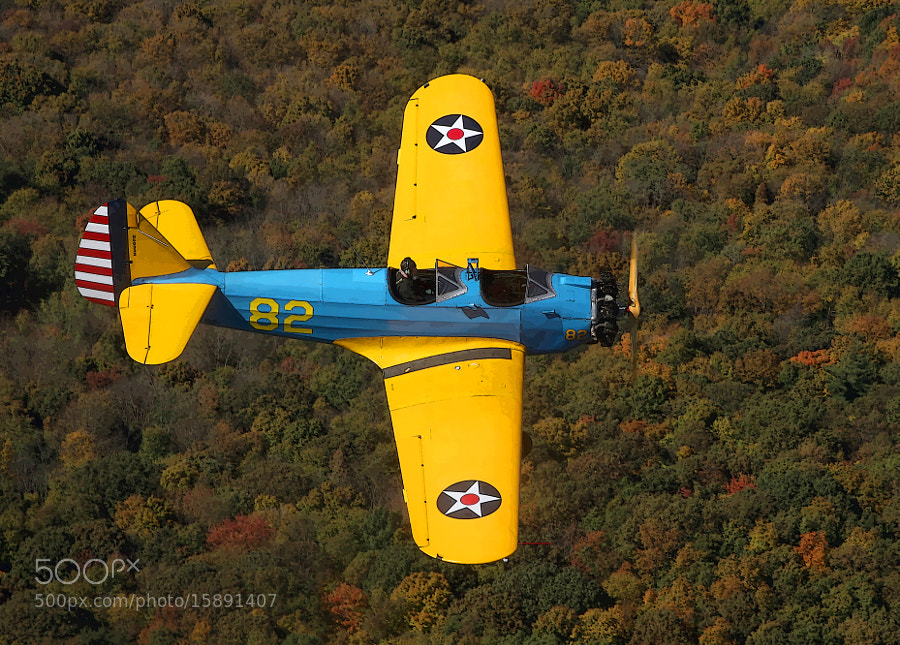 Nothing beats open cockpit flying on a cool, crisp, clear autumn morning in New England.  This image depicts a 1945 PT-23 Trainer from the World War Two era.  The PT-23 is the radial engined version of the PT-19.