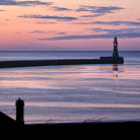 Pre sunrise glow in sky at Roker Pier