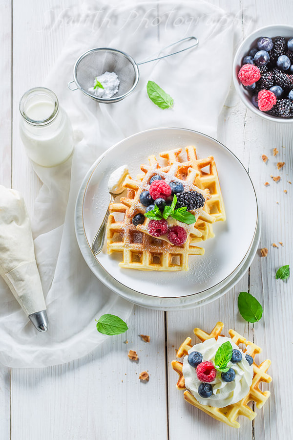 Waffles with berry fruits and whipped cream, автор — shaiith на 500px.com