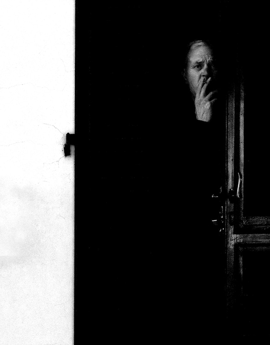 Photograph The man who smokes at the door by Massimo Genovesi on 500px
