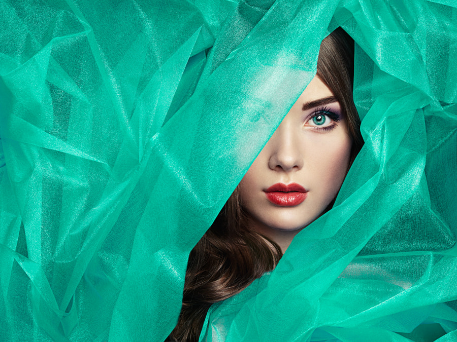 Fashion photo of beautiful women under turquoise veil by Oleg Gekman on 500px.com