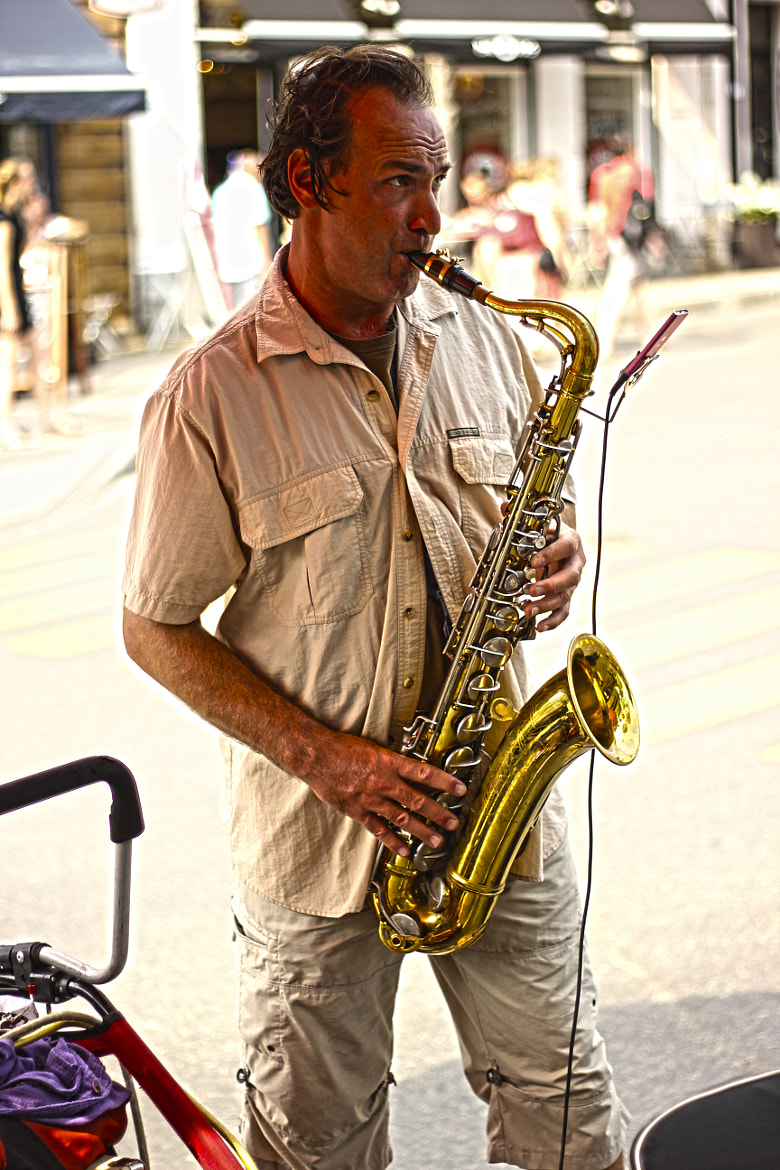 Photograph Street Saxophonist by Tomás Cortés on 500px