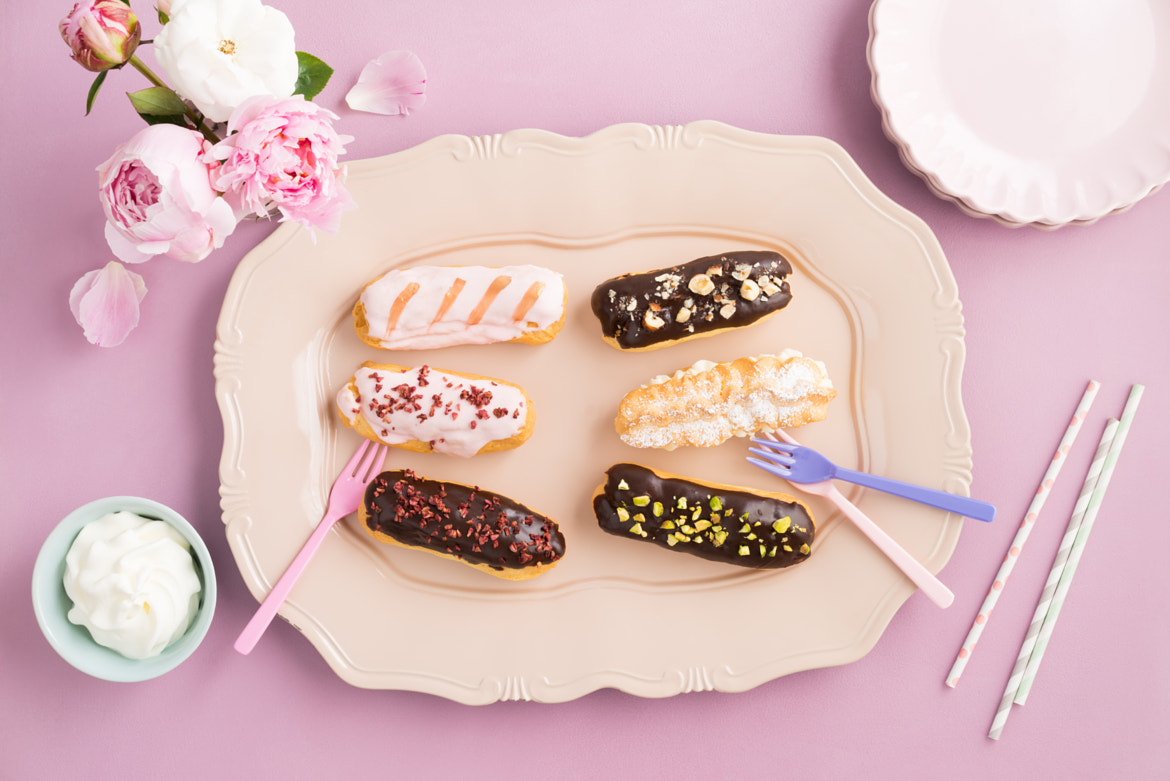 Eclairs with ganache and toppings