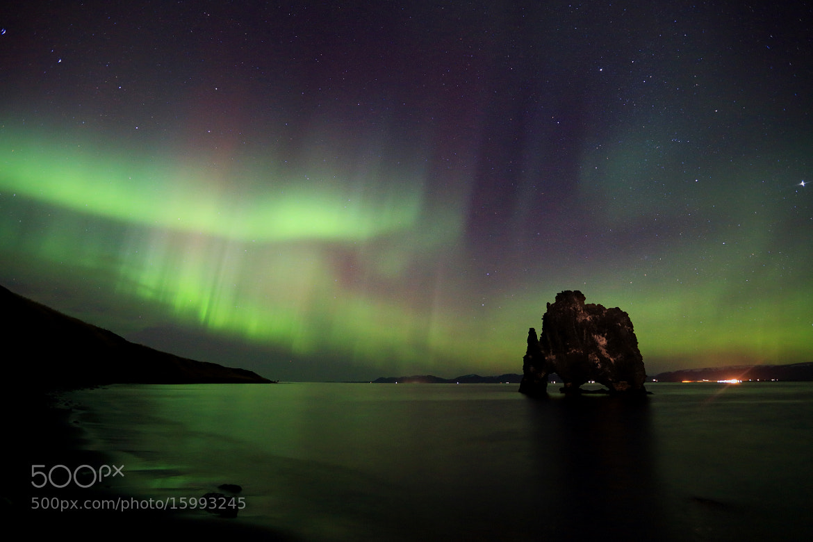 Photograph The Rock and the Northern Lights by Jon Hilmarsson on 500px