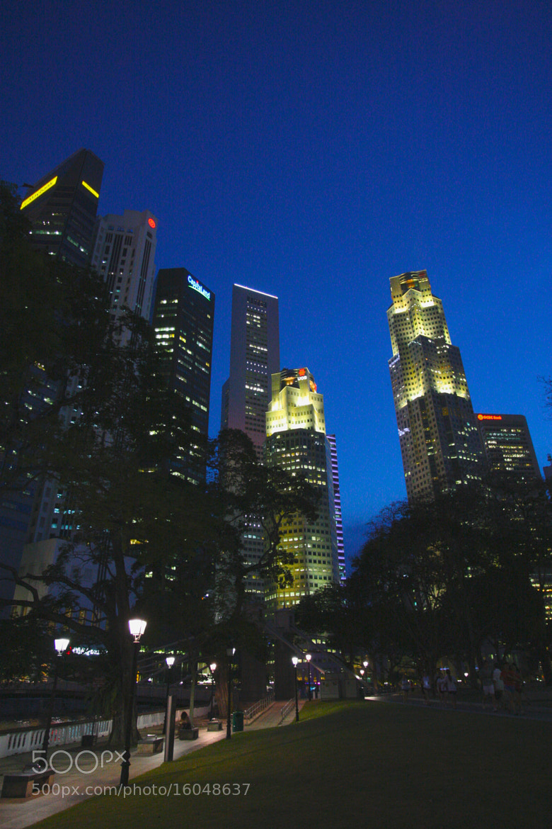 Photograph The Blue Hour at Raffles Place in Singapore by GengHui Tan on 500px
