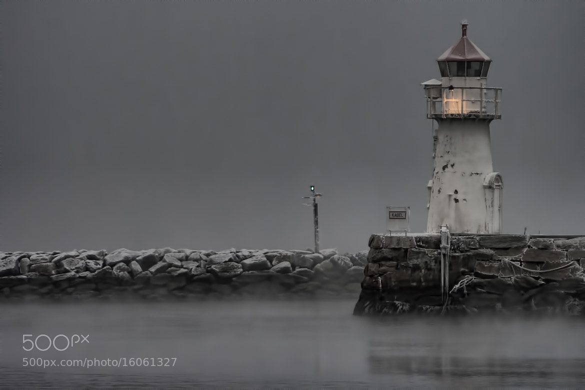 Photograph Frozen Lighthouse by Olaf Aune on 500px
