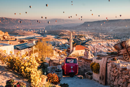 Balloons over Uchisar town in Cappadocia. by Janet Weldon on 500px