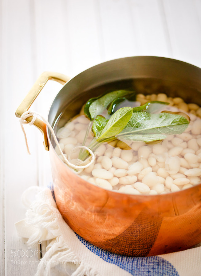 beans, simply cooked with garlic and sage. Dressed with olive oil, salt and pepper before serving.