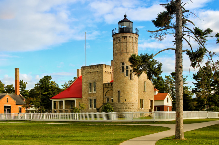 """""""Old Mackinac Point Lighthouse""""     Starting in 1889, Old Mackinac Point Lighthouse helped ships navigate their way through the quite treacherous waters of the Straits of Mackinac. Crossing between Lake Huron, and Lake Michigan."""