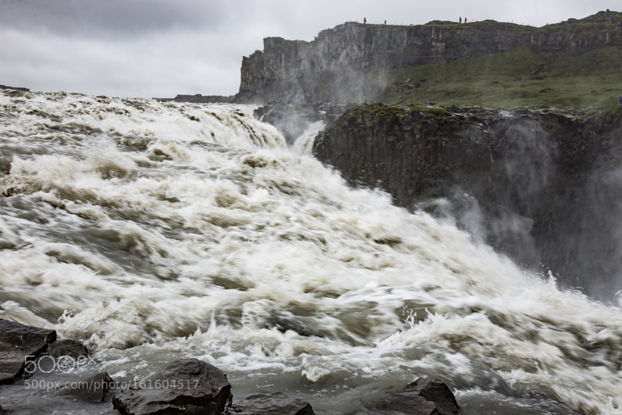 At the edge of the Dettifoss waterfall in Iceland
