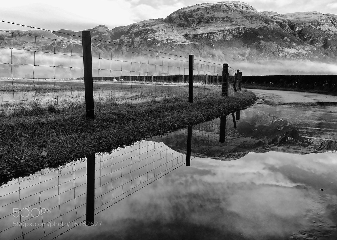 Photograph flooded road  by ian mcintosh on 500px