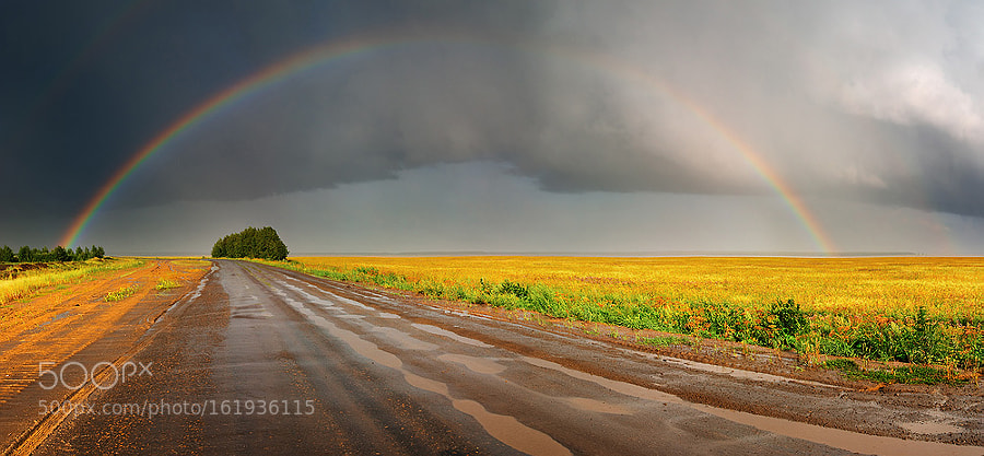 Rainbow over road by muha0445