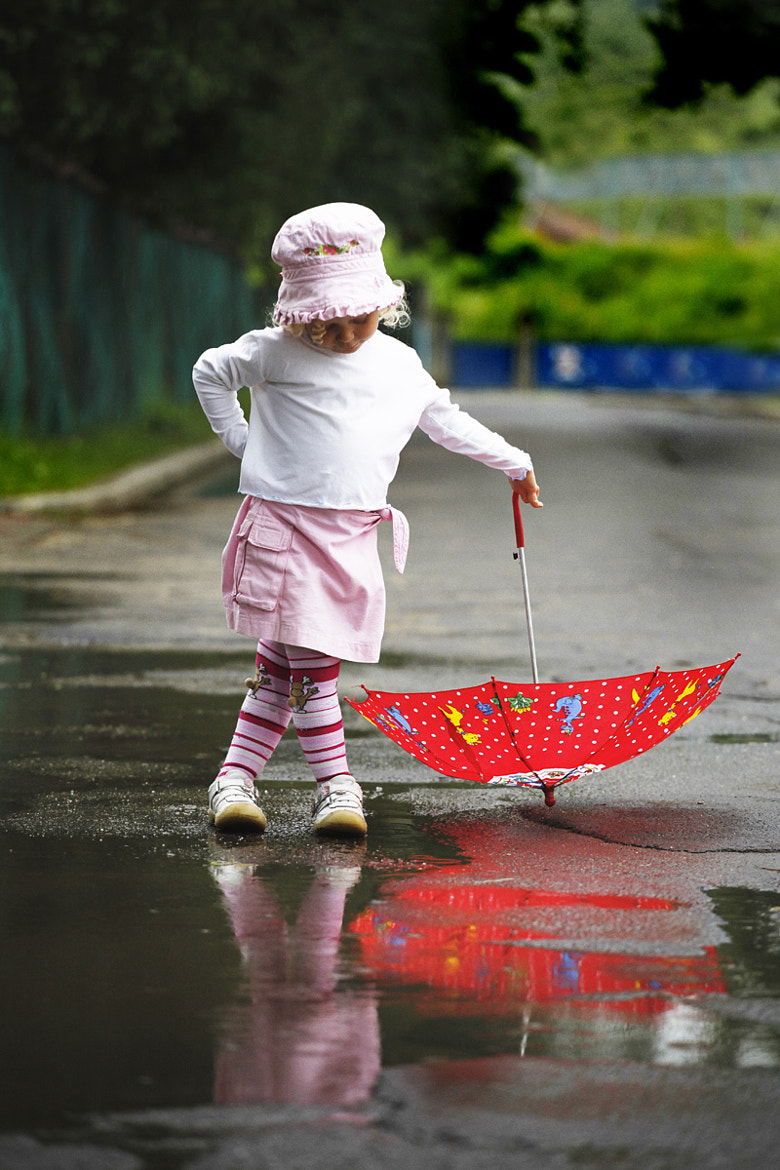 Photograph Little girl with umbrella by Nagy Florian on 500px