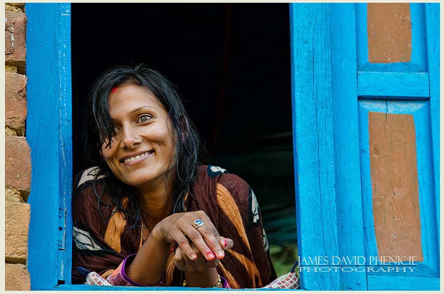 Faces of Nepal:   Lady in Window