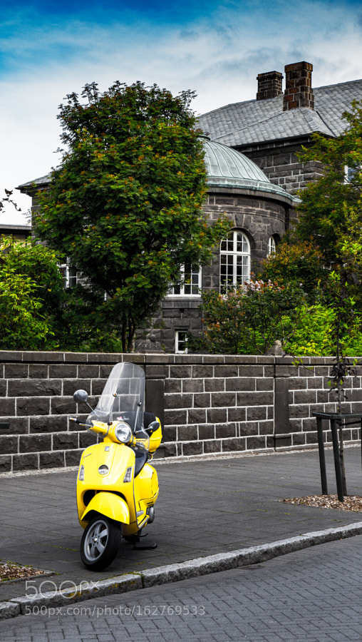 A Vespa in front of the Parliament in Reykjavik