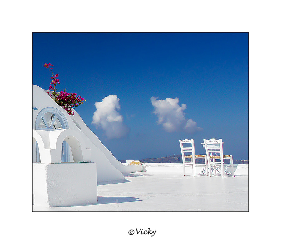 Photograph two chairs and two clouds, Santorini by Vicky Dens on 500px