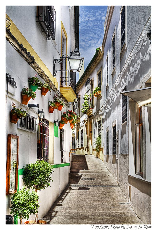 Photograph Narrow streets series:streetlights and planters in Cordoba by Juana Maria Ruiz on 500px