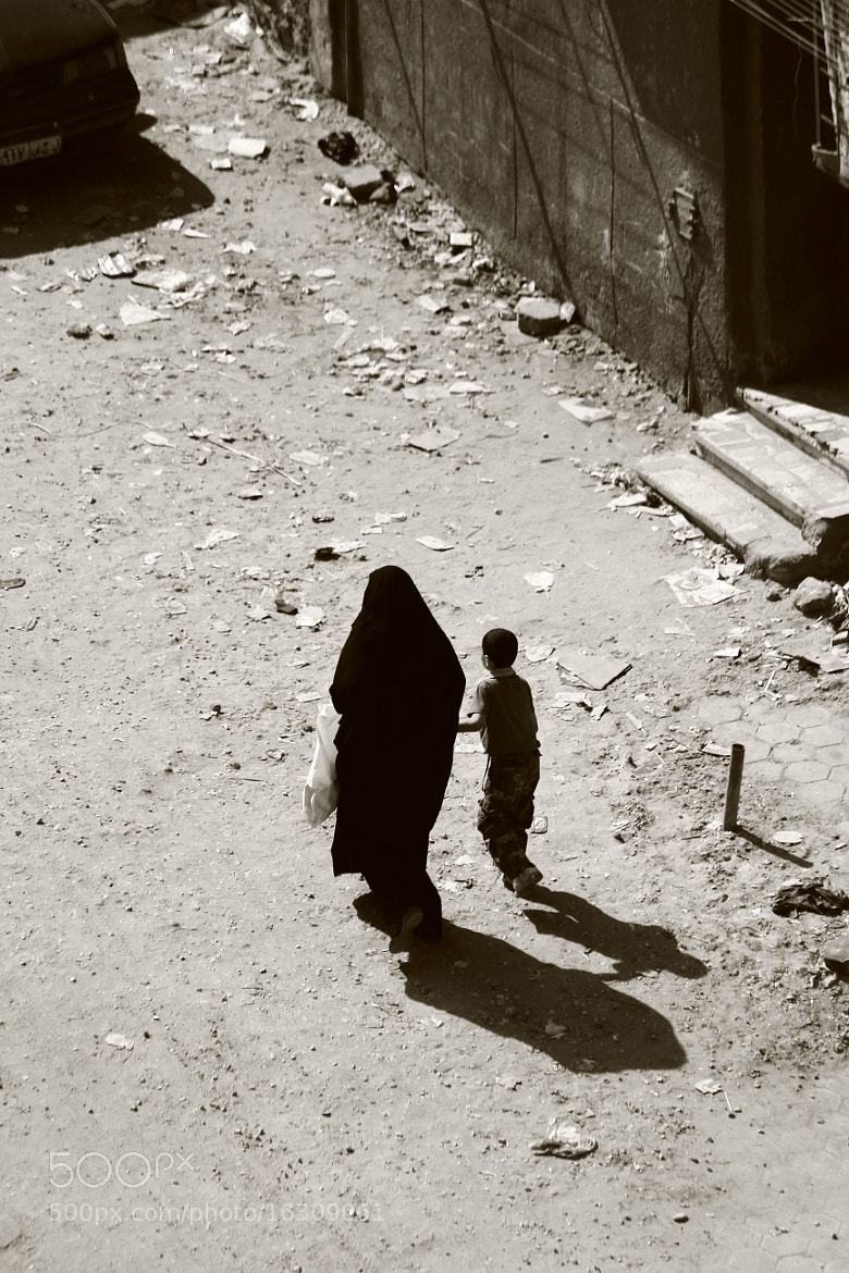 Photograph Mother and her son\Shadows of walking peopl by AMJAD AGGAG on 500px