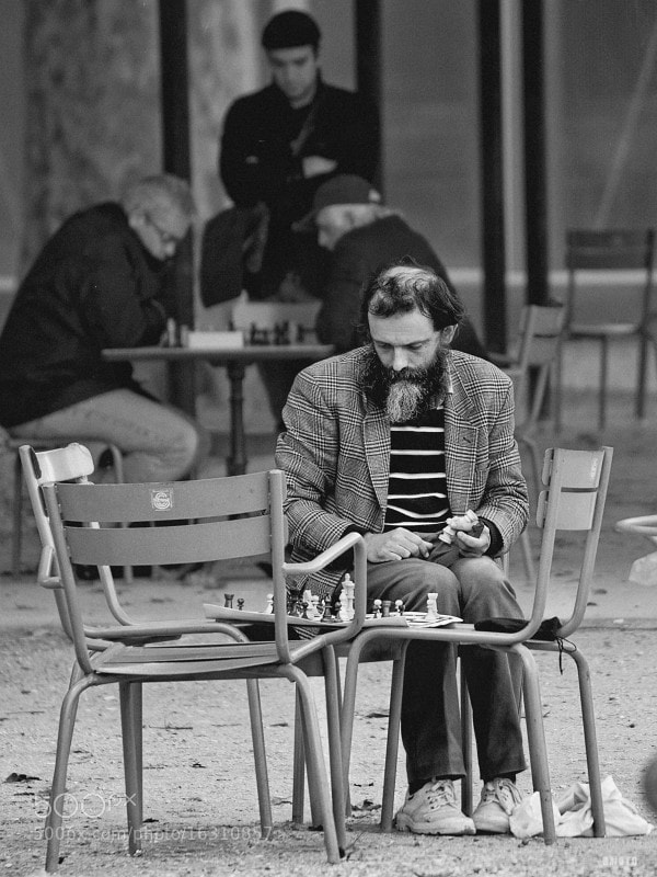 """A chess player focusing on his game, at the Luxembourg park.   <a href=""""http://nightgrain.tumblr.com/"""">Photoblog</a>"""