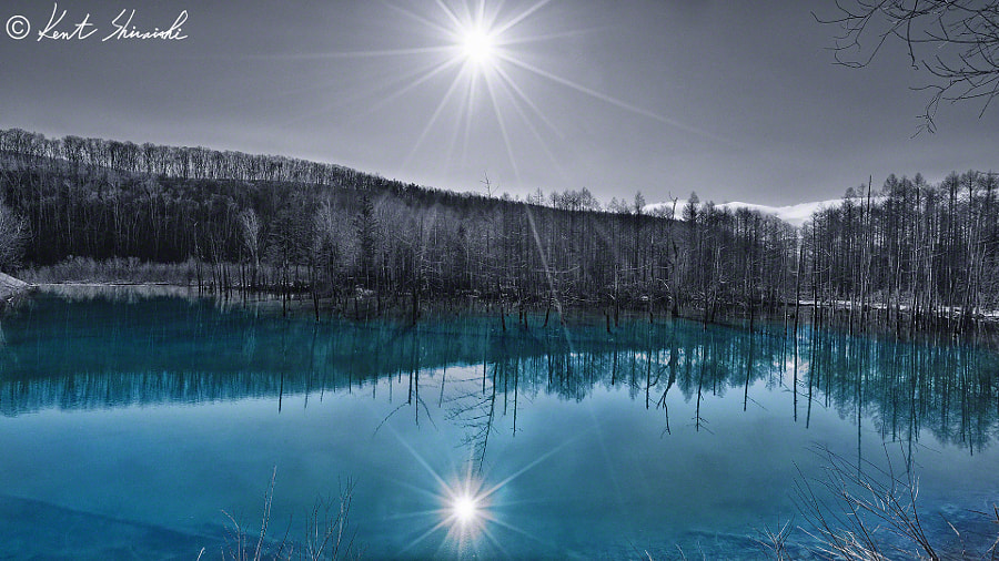 v2?webp=true&sig=16232f5f0971920a01fa05c602f01ee86e47cad0ed1710f71452dbfb6cb5cf3e L'étang bleu d'Hokkaido en toutes saisons par Kent Shiraishi