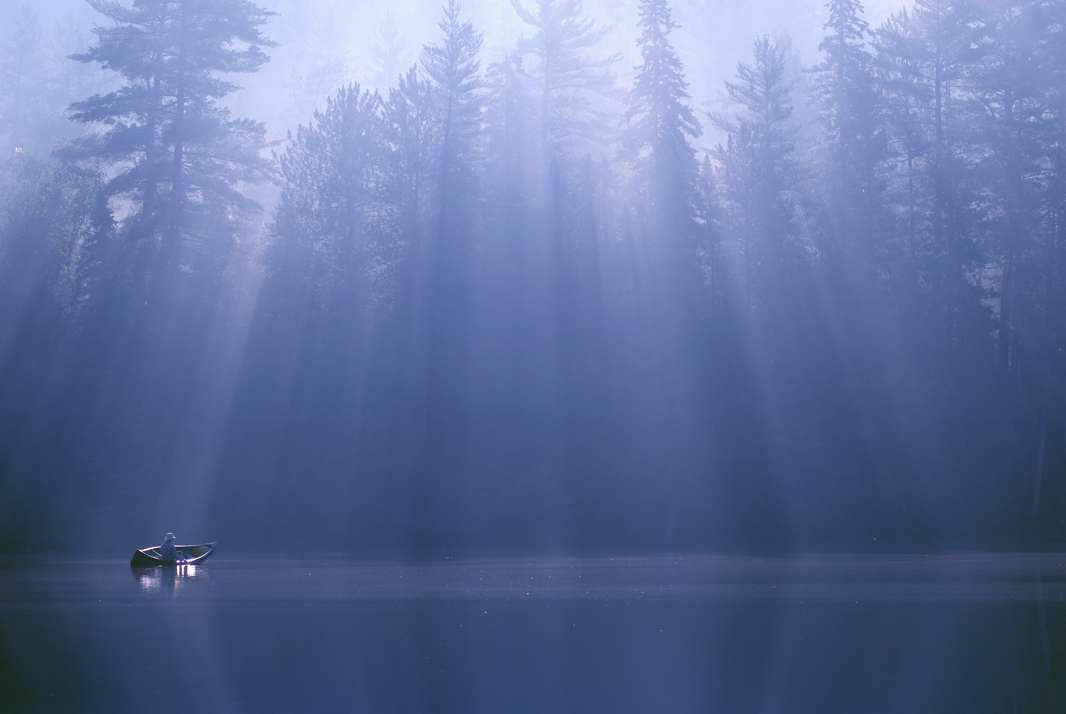 Photograph Sunrays & Canoe, Dumoine River by Peter Bowers on 500px