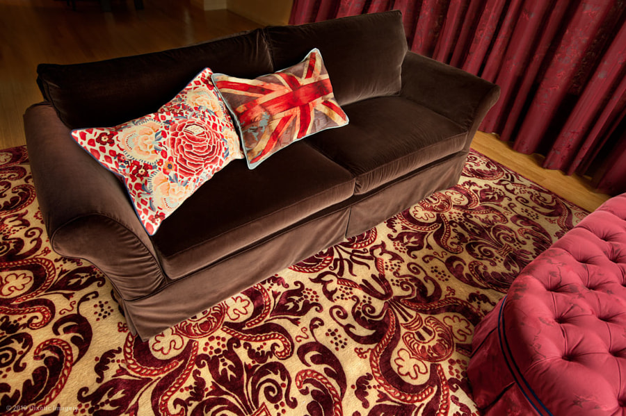 The sofa and carpet in the living room designed by Cristina Hadzi for a client in Liberty City, NYC