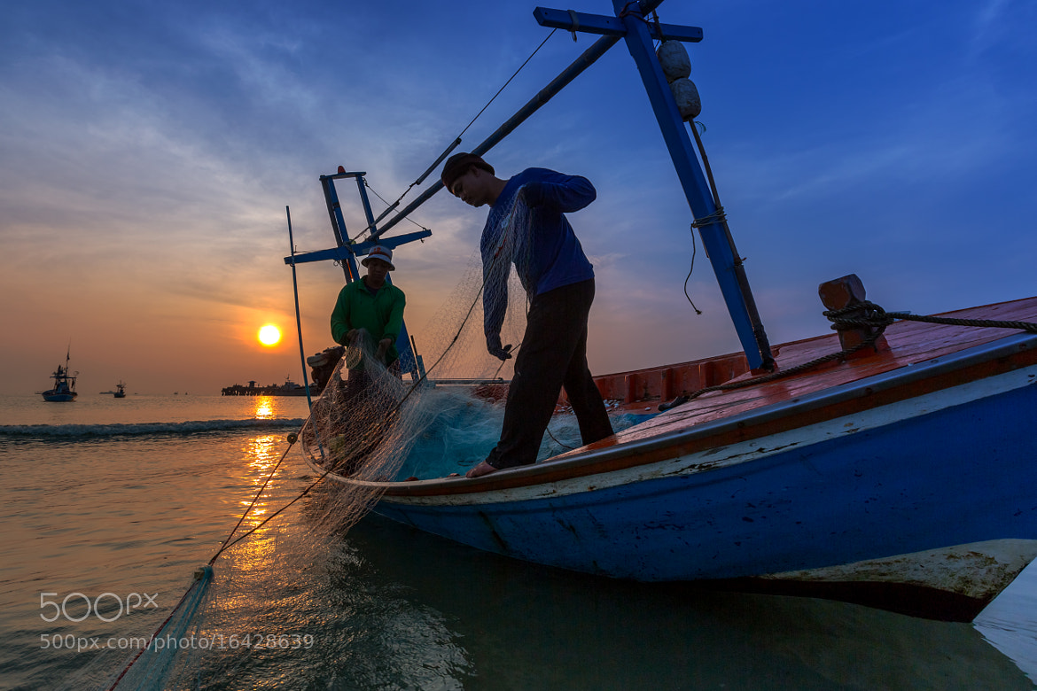 Photograph Sunset with fisherman work by Arthit Somsakul on 500px