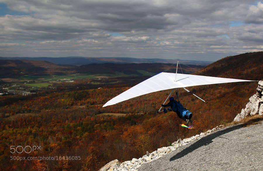 Note the rainbow colored windsock is straight out, fully deployed as this Hang Glider launches from a mountain top near Chambersburg, PA