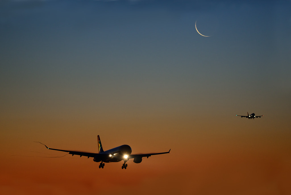 Photograph Crescent Moon Arrivals at Heathrow by Phil Royal / Depthoffieldimages.co.uk on 500px